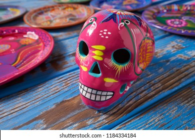 Mexican pink skull dia muertos crafts in Mexico of deaths day