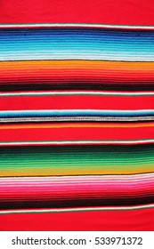 Mexican Poncho Background textile fiesta cinco de mayo Mexican theme local market made Mexicana traditional culture serape fabric with copy space