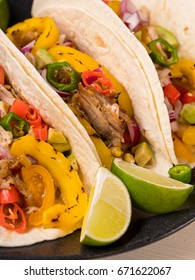 Mexican pork carnitas tacos with salsa on wooden rustic background. Big size resolution food photo.