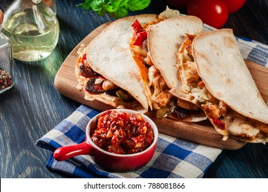 Mexican Quesadilla with chicken, sausage chorizo and red pepper served with salsa