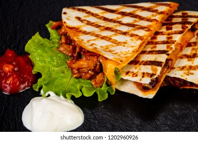 Mexican quesadilla with meat and vegetables
