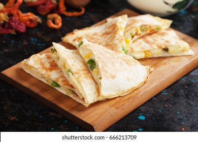 Mexican quesadillas, cheese filled tortilla wraps with salsa and guacamole