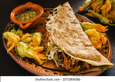 mexican quesadillas with squash blossom, cheese and sauce