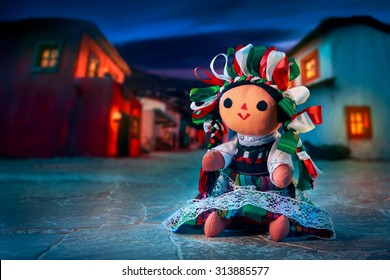 Mexican rag doll in a traditional dress at night