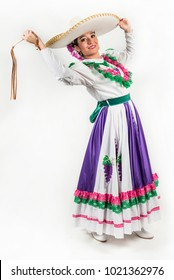 Mexican regional dancing dress This charming dancer is wearing a picturesque dress used in the state of Aguascalientes in Mexico. She uses a whip during her performance