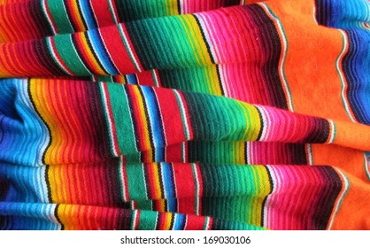 Mexican rug poncho serape blanket fiesta background traditional handwoven with stripes and bright colors stock, photo, photograph, image, picture