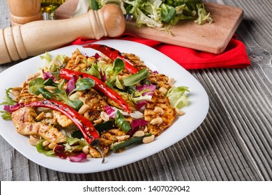 Mexican salad with hot pepper chiken fillet lettuce on plate