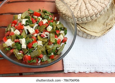 Mexican salad with nopal cactus  in a bowl beside mexican tortillas