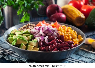 Mexican salad with quinoa, red beans, avocado, corn and tomatoes