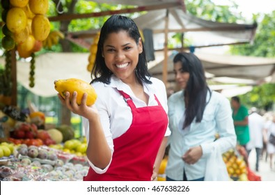 Mexican saleswoman on a farmers market selling fresh fruits