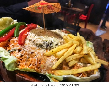 Mexican sizzler food dish with french fries