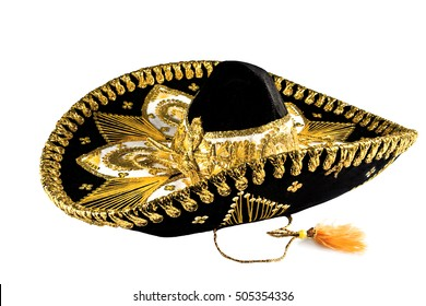 Mexican sombrero hat in black with ornate gold trim isolated on white background