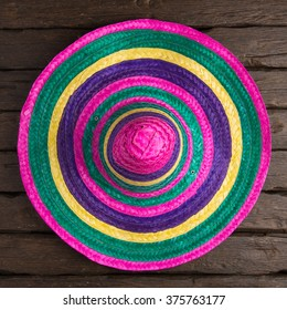Mexican sombrero on old dark wood background.