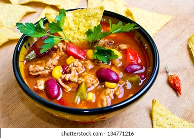Mexican soup (like chili con carne) with tacos
