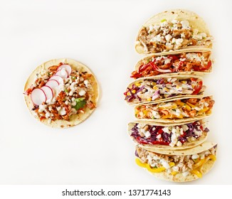 Mexican street food. Varied traditional mexican corn tacos flat lay composition.