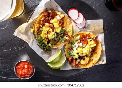 mexican street tacos with beer shot top down