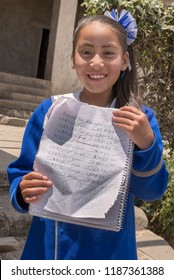Mexican student showing good grade result  Very proud Mexican young student showing her good grades received in her homework