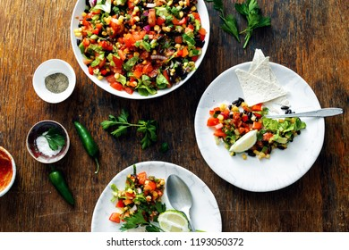 Mexican taco salad on wooden table, top view