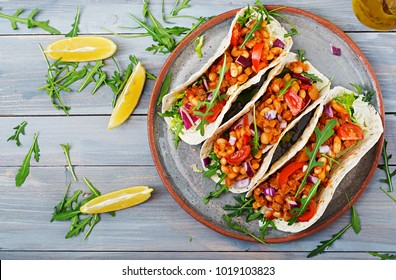 Mexican tacos with beef, beans in tomato sauce and salsa. Flat lay. Top view.