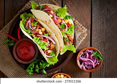 Mexican tacos with meat, vegetables and red onion. Top view