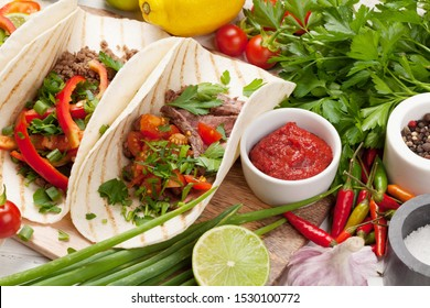 Mexican tacos with meat and vegetables. Spices and ingredients