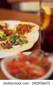 "Mexican Tacos ""Pastor"" and ""Carnitas"" with pork and beef in yellow tortilla"