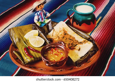 Mexican tamales of corn leaves with atole and sauces, mexican traditional food
