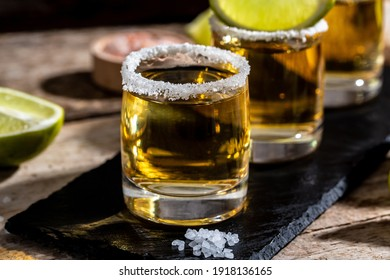 Mexican tequila with lime and salt on rustic black background. space for text. luxury drink. Alcoholic drink concept.