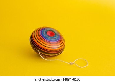 mexican toys, yoyo from Wooden in Mexico on yellow background