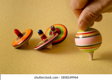 Mexican trompo and pirinolas, traditional Mexican toy with bright colors