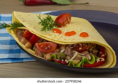Mexican Tuna tortilla with bean and tomato