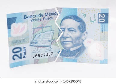 Mexican twenty peso bill, cut in half.