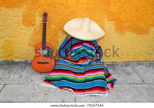 Mexican typical lazy man sombrero hat guitar serape nap siesta