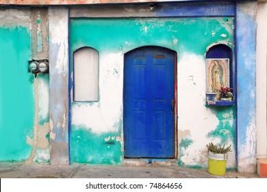 Mexican virgin madonna figure house facade tropical Caribbean Guadalupe
