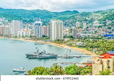 A Mexican warship in Acapulco Bay, location of Acapulco, a city, tourist resort and major seaport in the state of Guerrero on the Pacific coast of Mexico,