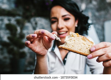 Mexican woman eating rosca de reyes or Epiphany cake, Roscon de reyes with traditional mexican chocolate cup