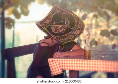 Mexican woman sleeping leaning on table