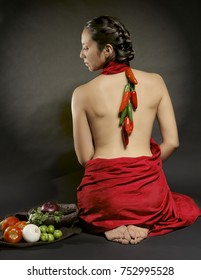 Mexican woman whit chillies