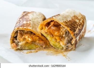 Mexican Wrap Burrito with Steak Fillet, Guacamole Sauce, Sour Cream, Pico De Gallo, Mozzarella Cheese and Potatoes / California Style.