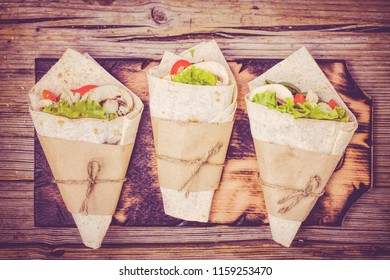 Mexican Wraps Wrapped tortilla and burrito with various fillings from chicken, vegetables, shrimp, avocado, corn