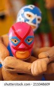 Mexican wrestlers dolls, very shallow depth of field.