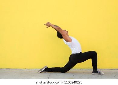 Mexican yoga teacher. Tatoos in Sanskrit meaning Ahimsa (non violence) and Karuna (compassion).