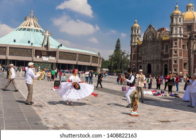 Mexico August 18, 2018 Basilica of Our Lady of Guadalupe. The old and the new basilica, group of people dancing to the virgin of Guadalupe.