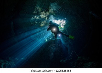 Mexico cenotes cave diving ray lights