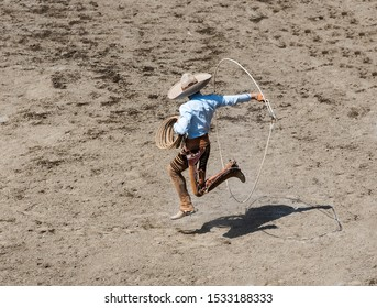 Mexico, Charro jumping in the circle of lazzo in a square, view from above