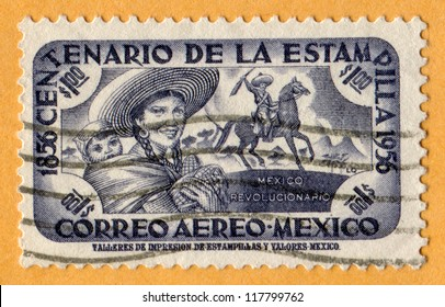 MEXICO - CIRCA 1956: A stamp printed in Mexico, shows Woman and Child and Horse back Rider, Revolutionary Mexico. Scott Catalog AP90 (Centenario de la Estampilla Mexico Revolucionario), circa 1956