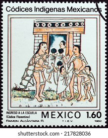 """MEXICO - CIRCA 1982: A stamp printed in Mexico from the """"Native Mexican Codices - Florentine Codex """" issue shows Admission to School, circa 1982."""