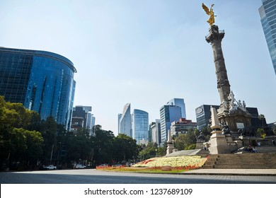 Mexico city Mexico 11/22/2018 Angel of Independence roundabout in Reforma avenue with modern buildings on the background on a beautiful sunny day