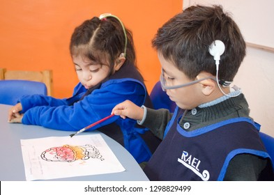Mexico City, Mexico. 16 Nov 2018: Deaf Kids on the school working with watercolors