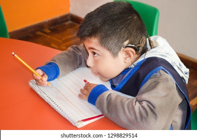 Mexico City, Mexico. 16 Nov 2018: Deaf Kid taking notes on the school